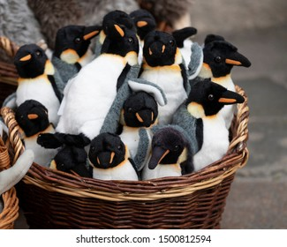 penguins are soft toys. wicker basket with stuffed toys - penguins
