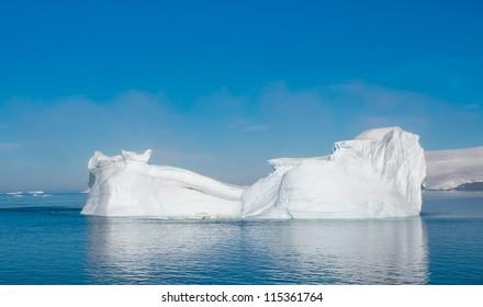 Penguins traveling on the beautiful iceberg