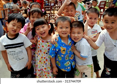 Pengzhou, China - May 24, 2007:  A group of smiling Chinese children at the Miao-Miao school on National Children's Day