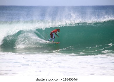 PENICHE, PORTUGAL - OCT 13: Owen Wright tube riding a wave in round 1, heat 7 at WCT contest, Rip Curl Pro in Peniche, Portugal on October 13, 2012
