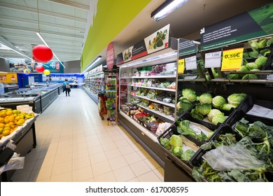 Peniche, Portugal - October 10, 2016: Supermarket sales area. Vegetable Section, shelves and refrigerators with other goods