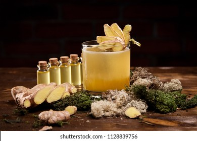 Penicillin cocktail with ginger on wooden background