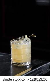 Penicillin cocktail on a bar desk. black background.