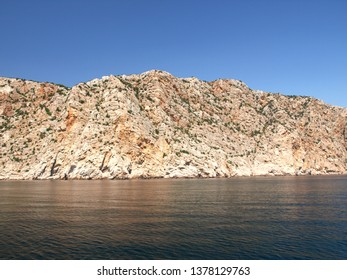 The peninsula of Crimea and Black sea. Rocks and cliffs of the southern coast of Crimea in the area of Fiolent. Plateau fragment of the Main Ridge of the Crimean Mountains. Kaya-Bach heights