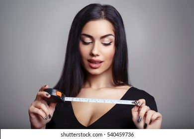 Penis Size Concept. Woman with Measuring Tape