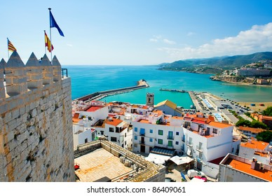 Peniscola port, view from castle Papa Luna, landmark of the city. Turquoise bay of Mediterranean Sea, bright, colours, sunny day. Popular travel destinations, touristic place.  Costa del Azahar, Spain