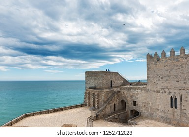 PENISCOLA, SPAIN - MARCH 30, 2018: Aerial view of the fortified city of Peniscola in the Costa del Azahar in Castellon on a rainy day, Valencian Community in Spain.