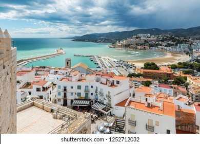 PENISCOLA, SPAIN - MARCH 30, 2018: Aerial view of the fortified city and port of Peniscola in the Costa del Azahar in Castellon on a rainy day, Valencian Community in Spain.