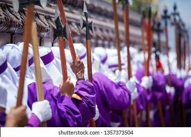 ¨Cucuruchos¨ (penitents) carrying on shoulders the heavy wooden float of the procession of La Merced, Antigua Guatemala during Good Friday.