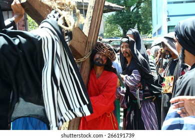 Penitents reenacting the Passion of Christ. Penitents reenacting the Passion of Christ in Cainta, Rizal in the Philippines. Held on Good Friday, April 3, 2015 as part of celebration of the Holy Week.