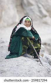 PENJICENT, TAJIKISTAN - OCTOBER 14, 2007: Unidentified Tajik woman rests  near Marguzor lake, Oct 14, 2007, Tajikistan.Substantial number of older people live in poverty in Tajikistan.