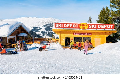 Penken, Austria - February 6, 2019: People at ski school and at restaurant and cafe chalet house on Penken Park ski resort in Tyrol in Mayrhofen in Zillertal valley in Austria in winter Alps