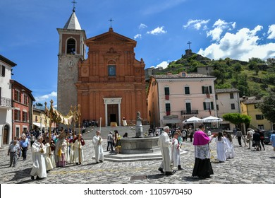 Pennabilli, Italy - 3 June 2018: Faithfuls and priests take part in the Corpus Christi religious celebrations in front of the church of the traditional village. Beautiful sunny day. In the background