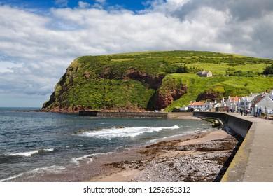 Pennan, Aberdeenshire, Scotland, UK - June 17, 2018: Shore of Pennan coastal fishing village in Aberdeenshire Scotland UK featured in film Local Hero