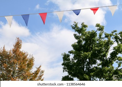 Pennant chain in front of trees in fine weather