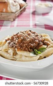 Penne Bolognese. Food photography. Italian cuisine accompanied by bolognese sauce.