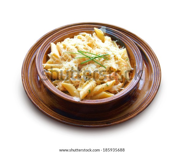 Penne with chicken breast and cheese on a clay bowl, isolated on white background with clipping path