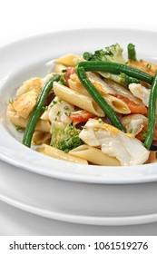 penne with cod chips and vegetables