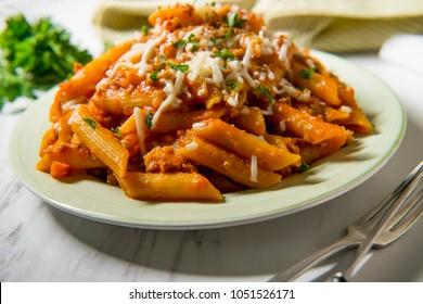 Penne Italian ragu alla Bolognese sauce with shredded mozzarella and toasted garlic bread crumbs