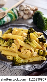 Penne pasta with broccoli and chicken with cheese sauce