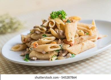 penne pasta cream cheese on table