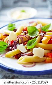 Penne pasta with peppers and basil