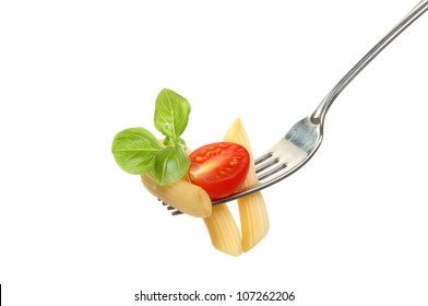 Penne pasta with tomato and basil leaves on a fork isolated against white