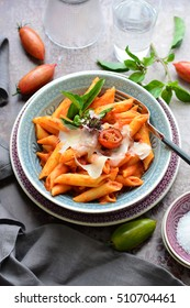 penne with tomato sauce, basil and parmesan
