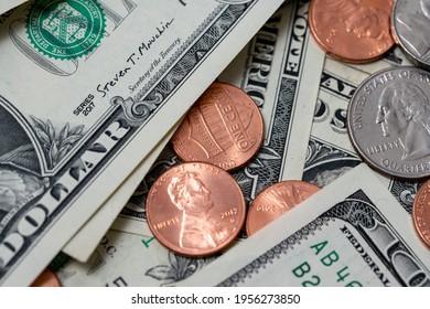 Pennies between dollar bills. US dollar paper money and coins.