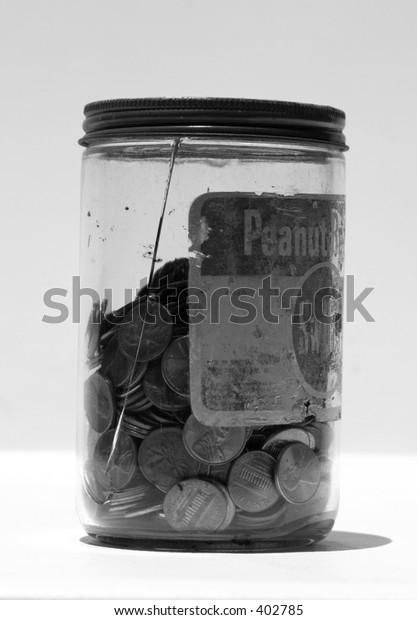 pennies in a jar in black and white