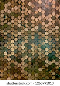 Pennies in a line of various colors, some worn, some newer, all worth one cent.