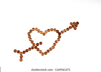 Pennies in the Shape of a Heart with an Arrow Through It