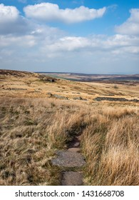The Pennine Way footpath on moorland close to Top Withins, an historic site in West Yorkshire, UK, on 14 April 2018. Top Withins is reputedly the site that inspired Emily Brontë's 'Wuthering Heights'.