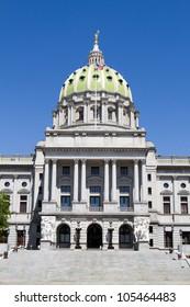 Pennsylvania capitol dome in Harrisburg, Pennsylvania, USA against a blue sky.