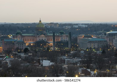 Pennsylvania's Capitol building in Harrisburg illuminated with lights at sunset.  Picture taken from the east (back) side of the building.