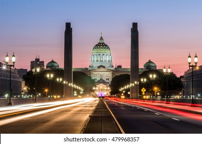 Pennsylvania's Capitol building as seen from the center of State Street. Long exposure photography produced blurs from the vehicles head and tail lights.