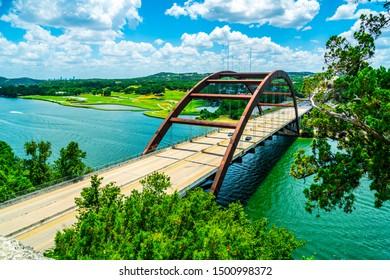 Pennybacker Bridge or 360 Bridge of Austin Texas Landmark Suspension Bridge spanning across the Colorado River nature landscape green summer view
