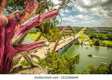 Pennybacker Bridge or 360 Bridge an Austin Texas Landmark Tree Overlook view of the Texas Hill Country Landscape Vast Highway Suspension Bridge the spans across the Colorado RIver