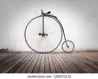 penny-farthing, high  wheel retro bike  on wood floor