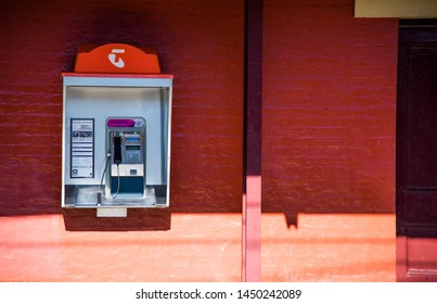 PENRITH, AUSTRALIA. - On June 09, 2019. - Telstra public payphone, is Australia's largest telecommunications company on a orange wall at railway station.