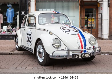 PENRITH, ENGLAND - MAY 1:  A Volkswagon Beatle car awaits the May Day parade in Penrith town centre in Cumbria, England on May 1, 2017.  The car is decorated in the colours of Herbie the Love Bug.