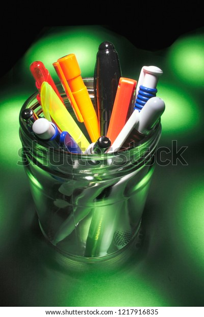 Pens Glass Jar On Green Background Stock Photo Edit Now