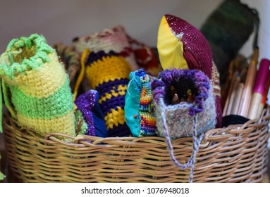 Pens in hand knitted wraps in Waldorf School in basket