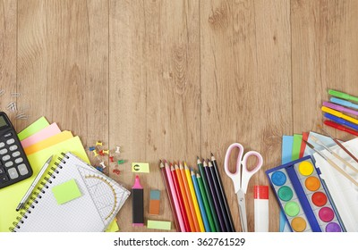 pens and paper for painting or creative tinker on wooden surface