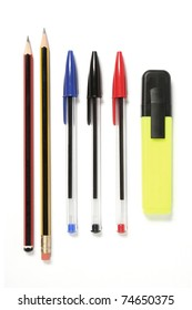 Pens, pencils and a Highlighter. Pens lined up, ready for action. Two pencils, three ball point pens and a hi-lighter pen. These shapes are standard in the UK. Isolated on white.