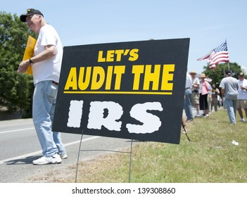 PENSACOLA, FL - 21 MAY: Protesters rally in front of local IRS office in Pensacola, FL on May 21, 2013 in response to news that conservative groups like the Tea Party were harassed by IRS officials.
