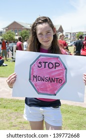 """PENSACOLA, FL - 25 MAY: Protesters in Pensacola, FL gather on May 25, 2013 to support worldwide """"March Against Monsanto"""" rallies over GMO (genetically modified) foods and lack of labeling."""