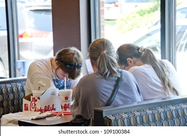 PENSACOLA, FL - AUGUST 1: Patrons pray at Chick-Fil-A restaurant in Pensacola, FL, on August 1, 2012 on national Day of Support following backlash from the owner supporting traditional marriage.