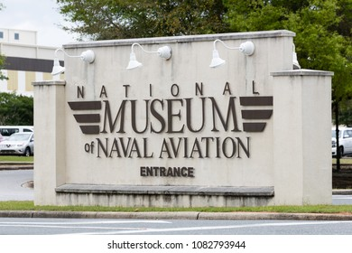 PENSACOLA, FLORIDA - APRIL 7: A sign depicting the entrance to the National Museum of Naval Aviation located in Pensacola, Florida, home of the Blue Angels.