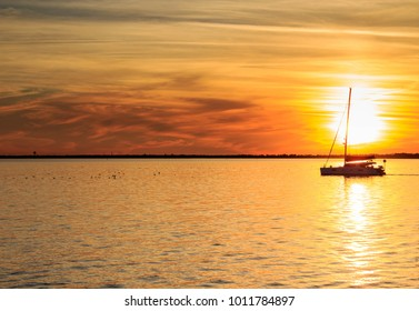 Pensacola Florida Sunset with sailboat in background